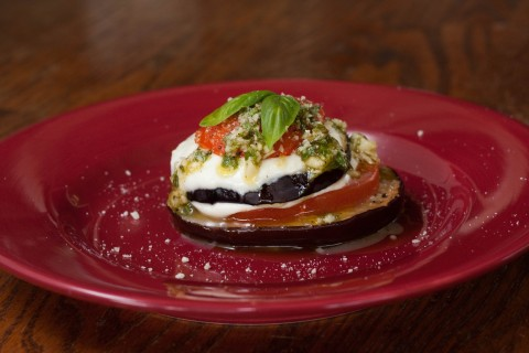 stack of eggplant. tomato, mozzarella mountains with pesto